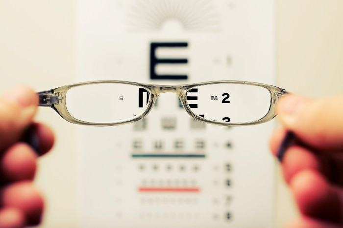 glasses clearing up vision of an eye test board by David Travis