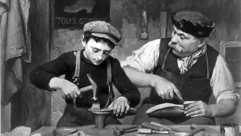 Cobbler and apprentice working