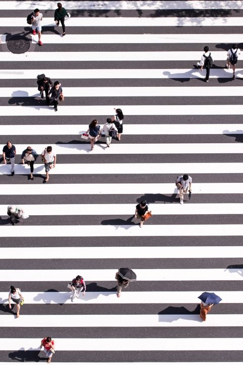 People crossing road by Ryoji Iwata
